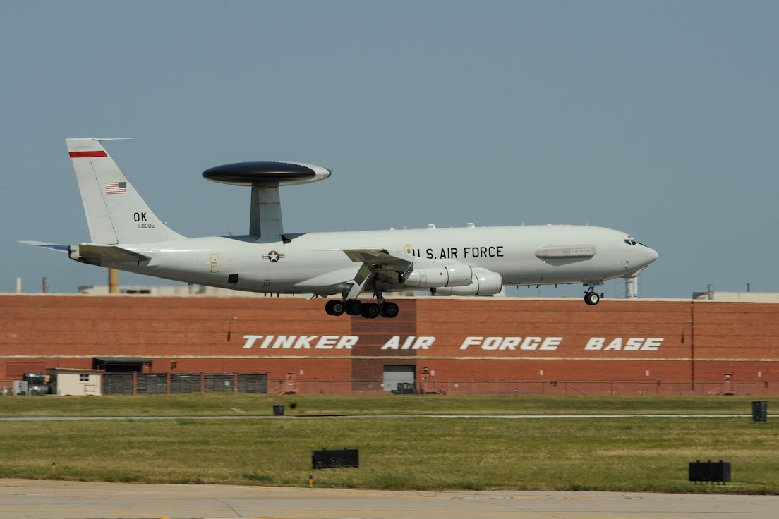 .A Boeing E-3G Airborne Warning and Control System aircraft on final approach to land June 16, 2017, Tinker Air Force Base, Oklahoma. The large building behind the E-3 AWACS is building 3001, a former Douglas Aircraft manufacturing plant during World War II, now used by the Oklahoma City Air Logistics Complex and its parent organization the Air Force Sustainment Center. The E-3 is operated by the 552nd Air Control Wing, Air Combat Command, from Tinker AFB where heavy maintenance of the E-3 airframe and engines is also conducted by the OC-ALC. (U.S. Air Force photo/Greg L. Davis)