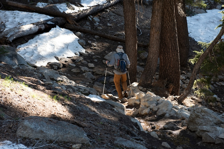 Retired U.S. Air Force Master Sgt. Terry Hendricksen, 60th Force Support Squadron outdoor recreation equipment repair technician, hikes toward lower elevation July 13, 2019, at Yosemite National Park, California. Hendricksen joined nearly four dozen Airmen from Travis Air Force Base, California, to hike to Cloud's Rest covering 14.57 miles as they climbed to 9,926 feet above sea level. The hike was organized to enhance the Airmen's physical, mental and spiritual resiliency. (U.S. Air Fore photo by Tech. Sgt. James Hodgman)