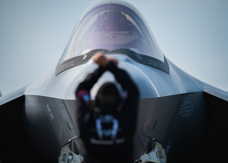 "Capt. Andrew ""Dojo"" Olson, F-35 Demonstration Team pilot and commander prepares to taxi out to the runway during the Arctic Lightning Airshow July 13, 2019, at Eielson Air Force Base, Alaska. The aerial demonstration consists of 16 maneuvers that fully showcase the capabilities of the F-35A Lightning II. (U.S. Air Force photo by Senior Airman Alexander Cook)"
