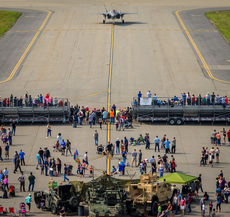 Airshow guests watch an F-35A Lightning II taxi down the runway following an aerial performance during the Arctic Lightning Airshow July 13, 2019, at Eielson Air Force Base, Alaska. Spectators got an up-close look at the Air Force's newest fighter jet marking the airshow since 2008. (U.S. Air Force photo by Senior Airman Alexander Cook)
