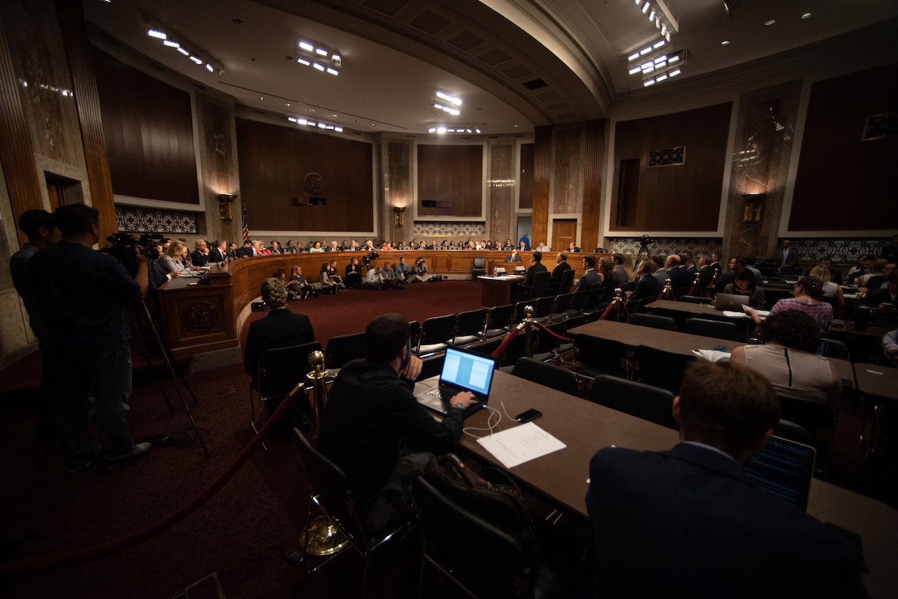 Wide-angle view of Senate committee hearing room.