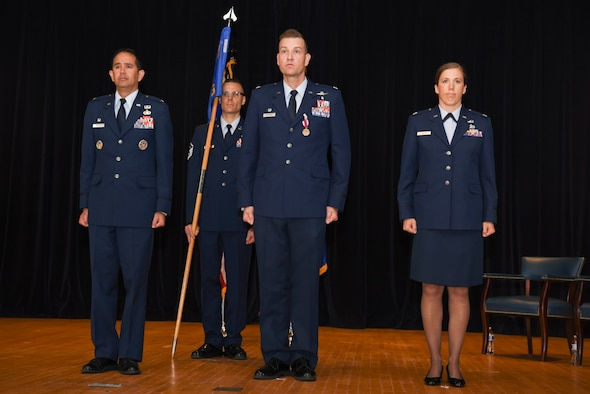 U.S. Air Force Col. Curtis Madeley, left, 707th Intelligence, Surveillance and Reconnaissance Group commander, Lt. Col. Stephanie Silva, center, incoming 707th Communication Squadron commander, and Lt. Col. Mark Betters, right, outgoing 707th CS commander, stand in formation during the 707th CS change of command ceremony at Fort George G. Meade, Maryland, July 10, 2019. Silva served as the deputy commander of the 707th CS for the past two years before assuming the role of commander. (U.S. Air Force photo by Senior Airman Gerald Willis)