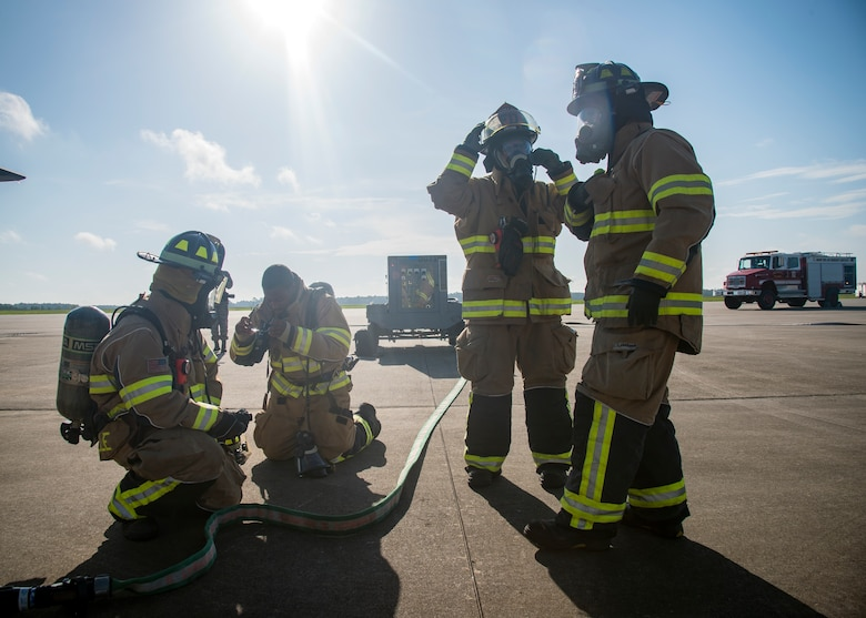 Firefighters from the 23d Civil Engineer Squadron (CES), don personal protective gear prior to HC-130J Combat King II egress training, July 11, 2019, at Moody Air Force Base, Ga. Firefighters conducted the training to evaluate their overall knowledge and proficiency of how to properly shut down and rescue personnel from a C-130 during an emergency situation. (U.S. Air Force photo by Airman 1st Class Eugene Oliver)