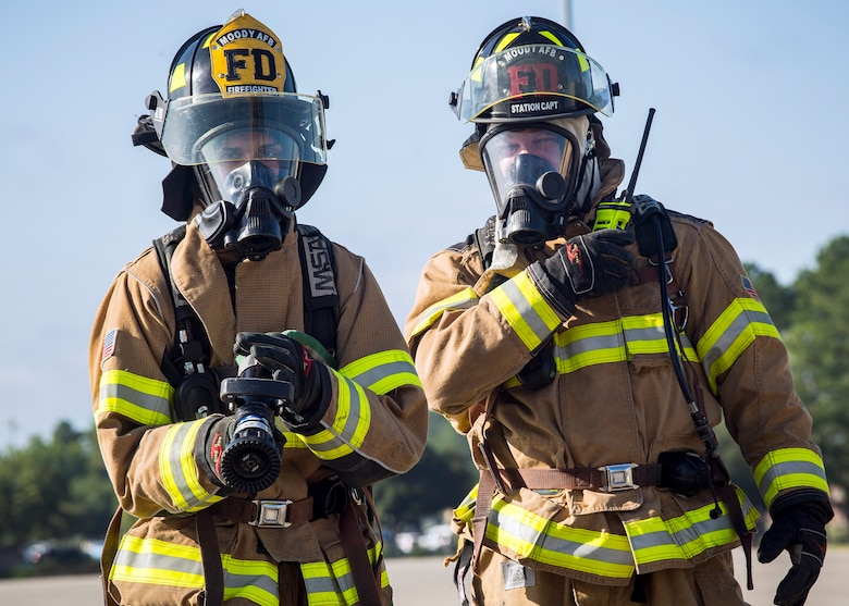 Tech. Sgt. Garey Schmidt, right, 23d Civil Engineer Squadron (CES) firefighter station chief, gives instruction during HC-130J Combat King II egress training, July 11, 2019, at Moody Air force Base, Ga. Firefighters conducted the training to evaluate their overall knowledge and proficiency of how to properly shut down and rescue personnel from a C-130 during an emergency situation. The training required the firefighters to properly enter and ventilate the aircraft while conducting swift rescue techniques to safely locate and remove passengers from the aircraft. (U.S. Air Force photo by Airman 1st Class Eugene Oliver)