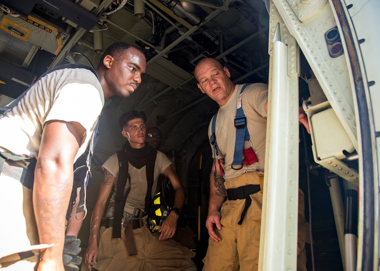 Tech. Sgt. Garey Schmidt, right, 23d Civil Engineer Squadron (CES) firefighter station chief, explains the internal components of an HC-130J Combat King II following egress training, July 11, 2019, at Moody Air Force Base, Ga. Firefighters conducted the training to evaluate their overall knowledge and proficiency of how to properly shut down and rescue personnel from a C-130 during an emergency situation. The training required the firefighters to properly enter and ventilate the aircraft while conducting swift rescue techniques to safely locate and remove passengers from the aircraft. (U.S. Air Force photo by Airman 1st Class Eugene Oliver)