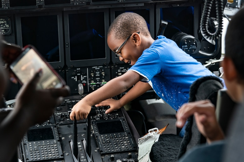 A participant moves the throttle of an HC-130J Combat King II during the Eyes Above the Horizon diversity outreach program, July 13, 2019, in Valdosta, Ga. The Valdosta Regional Airport hosted the Legacy Flight Academy and over 60 youths ranging in age from 10-19 for a day of flight introduction and immersion into the legacy of the historic Tuskegee Airmen. The program is designed to remove barriers for underrepresented minorities and inspire an interest in aerospace careers. (U.S. Air Force photo by Airman 1st Class Hayden Legg)