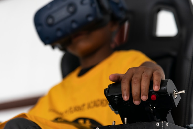 A participant uses a virtual reality flight simulator during the Eyes Above the Horizon diversity outreach program, July 13, 2019, in Valdosta, Ga. The Valdosta Regional Airport hosted the Legacy Flight Academy and over 60 youths ranging in age from 10-19 for a day of flight introduction and immersion into the legacy of the historic Tuskegee Airmen. The program is designed to remove barriers for underrepresented minorities and inspire an interest in aerospace careers. (U.S. Air Force photo by Airman 1st Class Hayden Legg)