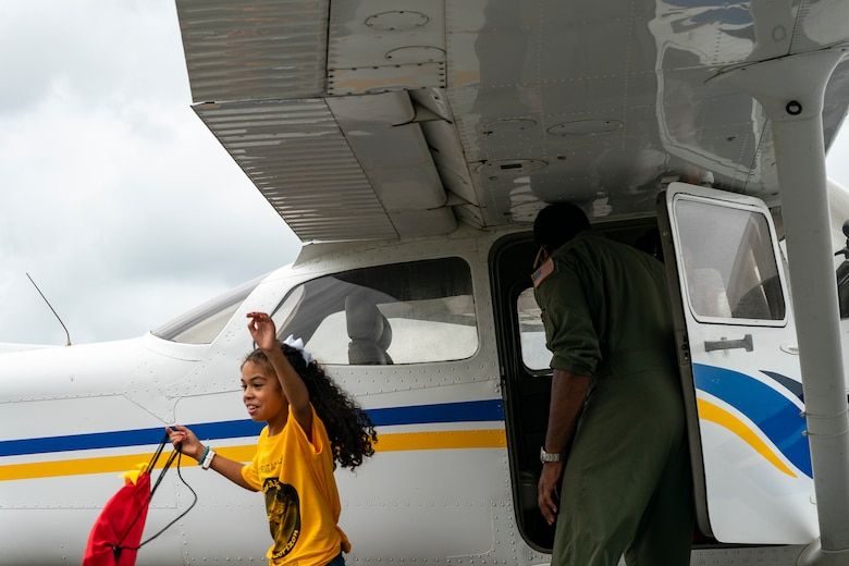 A participant exits an aircraft after an introductory flight during the Eyes Above the Horizon diversity outreach program, July 13, 2019, in Valdosta, Ga. The Valdosta Regional Airport hosted the Legacy Flight Academy and over 60 youths ranging in age from 10-19 for a day of flight introduction and immersion into the legacy of the historic Tuskegee Airmen. The program is designed to remove barriers for underrepresented minorities and inspire an interest in aerospace careers. (U.S. Air Force photo by Airman 1st Class Hayden Legg)