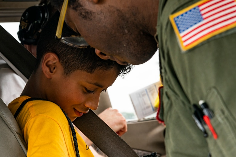 Capt. Wayne Walker, 164th Airlift Squadron pilot, straps a participant in for an introductory flight during the Eyes Above the Horizon diversity outreach program, July 13, 2019, in Valdosta, Ga. The Valdosta Regional Airport hosted the Legacy Flight Academy and over 60 youths ranging in age from 10-19 for a day of flight introduction and immersion into the legacy of the historic Tuskegee Airmen. The program is designed to remove barriers for underrepresented minorities and inspire an interest in aerospace careers. (U.S. Air Force photo by Airman 1st Class Hayden Legg)