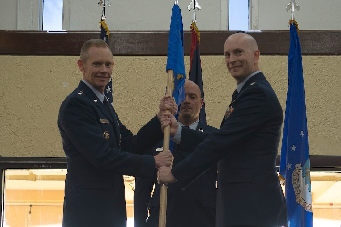 U.S. Air Force Lt. Col. Thomas Moncrief III, right, 8th Air Force Detachment 4 commander, takes the guidon from Maj. Gen. James Dawkins Jr., 8th Air Force and J-GSOC commander, during a change of command ceremony at Guam Air Base, June 28, 2019. Detachment 4 is a detachment under 8th Air Force at Andersen AFB, Guam, established by Air Force Global Strike Command to support bomber efforts in the Indo-Pacific region.   (U.S. Air Force photo by 36th Air Wing Public Affairs)