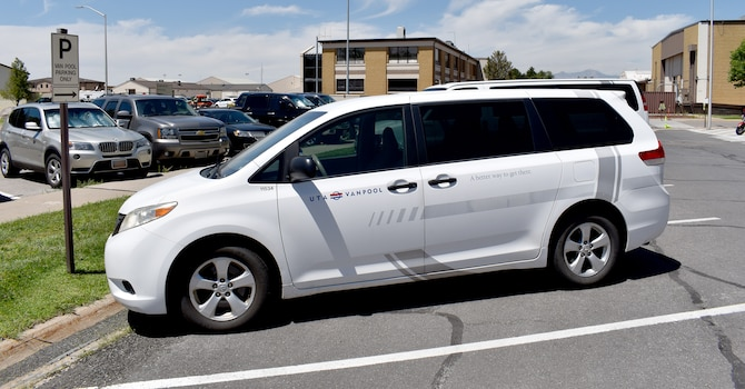 A Utah Transit Authority vanpool vehicle parked near building 100 at Hill Air Force Base, Utah, July 16, 2019. Hill AFB employees are saving money with the base public transit commuter program. The program, officially called the Transportation Incentive Program, has about 650 participants and more than 160 Utah Transit Authority vans that run on base.Vans have various pick up and drop off locations, including FrontRunner stations close to the base. (U.S. Air Force photo) (This photo has been altered by blurring out license plates.)