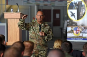 U.S. Air Force Gen. Jeff Harrigian, U.S. Air Forces in Europe and Air Forces Africa commander, discusses his priorities during an all-call at Hangar 814 on RAF Mildenhall, England, July 15, 2019. During the visit, Harrigian stressed the importance of strengthening partnerships through various exercises and a shared, common goal. (U.S. Air Force photo by Airman 1st Class Brandon Esau)
