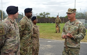 U.S. Air Force Gen. Jeff Harrigian, U.S. Air Forces in Europe and Air Forces Africa commander, discusses security measures with members of the 100th Security Forces Squadron at RAF Mildenhall, England, July 15, 2019. Harrigian made his first visit to RAF Mildenhall since assuming command in May 2019, speaking to Airmen on the importance of their mission and highlighting his vision. (U.S. Air Force photo by Airman 1st Class Brandon Esau)