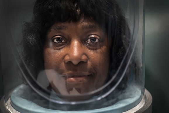 Gennette Jones, a hyperbaric patient, wears an oxygen hood inside a hyperbaric chamber at Brooke Army Medical Center May 31. Typical hyperbaric patients suffer from post-radiation injuries, decompression sickness, arterial gas embolism, chronic wounds, diabetics that have end-organ disease and poor circulation, sensory hearing loss, and burns.