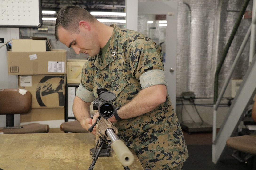 Capt. Nick Berger, a project officer in Marine Corps Systems Command's Infantry Weapons, demonstrates the MK13 Mod 7 July 1, aboard Marine Corps Base Quantico, Virginia. The system, which reached full operational capability in the second quarter of fiscal year 2019, shoots a more accurate bullet at greater distances than the legacy sniper rifle. Marines will primarily use the MK13 during deployments, while the M40A6 legacy rifle will be used for sniper training. (U.S. Marine Corps photo by Matt Gonzales)