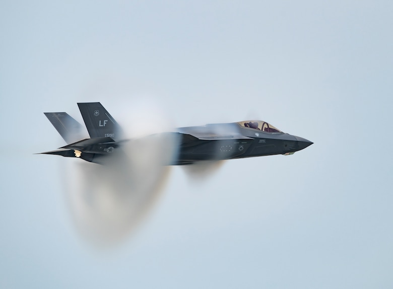 """Capt. Andrew """"Dojo"""" Olson, F-35 Demonstration Team pilot and commander performs a high-speed pass in an F-35A Lightning II during the Arctic Lightning Airshow July 13, 2019, at Eielson Air Force Base, Alaska. During the aerial maneuver, the jet reaches speeds of up to 750 miles per hour. (U.S. Air Force photo by Senior Airman Alexander Cook)"""