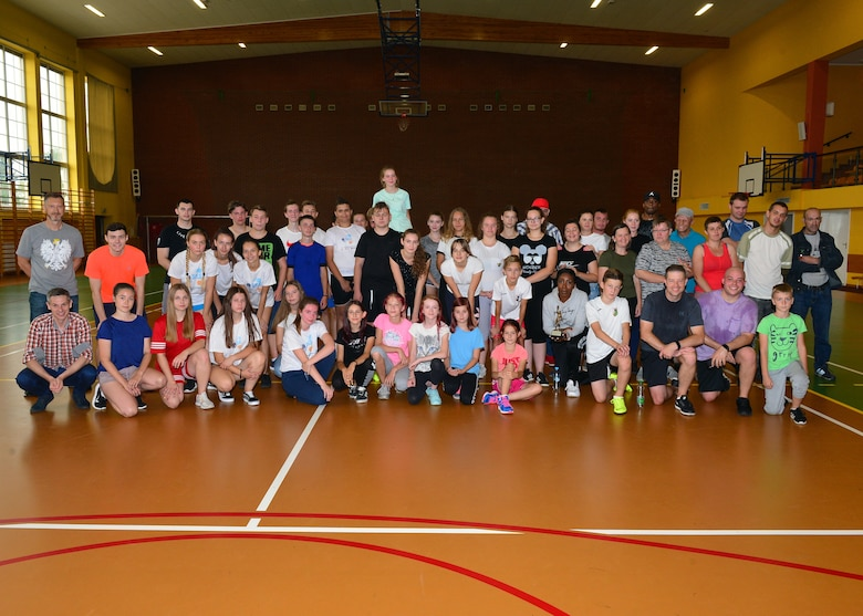 U.S. Airmen, students, and other community members attend a community outreach day event near Powidz Air Base, Poland, July 13, 2019. The students, Airmen, and other community members participated in basketball, a road clean up, and a barbeque. (U.S. Air Force photo by Staff Sgt. Jimmie D. Pike)