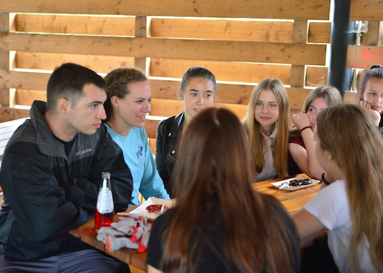 U.S. Airmen and students from Polish primary and secondary schools share their languages with each other near Powidz Air Base, Poland, July 13, 2019. The students, Airmen, and other community members participated in basketball, a road clean up, and a barbeque. (U.S. Air Force photo by Staff Sgt. Jimmie D. Pike)