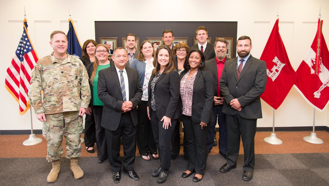 The graduating class of Huntsville Center's 2018-2019 Leadership Development Program Level II stands with Lt. Col. H. W. Hugh Darville, Huntsville Center commander, June 18, 2019.