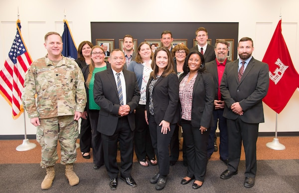 The graduating class of Huntsville Center's 2018-2019 Leadership Development Program Level II stands with Lt. Col. H. W. Hugh Darville, Huntsville Center commander, June 18, 2019.