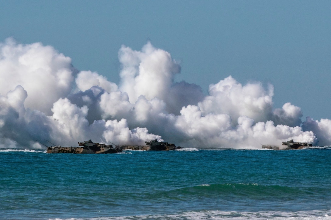 U.S. Marine amphibious assault vehicles give off tactical smoke as they approach Langham Beach, Queensland, Australia, July16, during Exercise Talisman Sabre 2019. Talisman Sabre 19 is a bilateral exercise that provides U.S. and Australian forces realistic and relevant training to strengthen regional security, peace and stability.