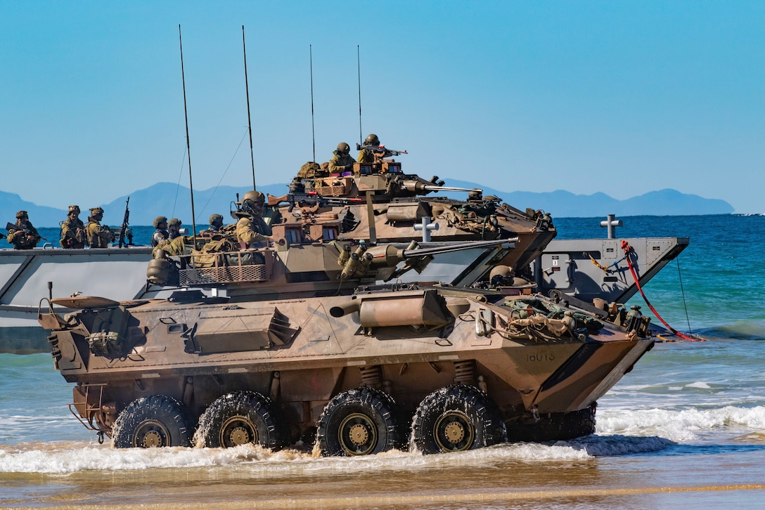 Australian Army soldiers with the 2nd Battalion, The Royal Australian Regiment, aboard a light armored vehicle-25, come off a landing craft onto Langham Beach, Queensland, Australia, July16, during Exercise Talisman Sabre 2019. Talisman Sabre 19 is a bilateral exercise that provides U.S. and Australian forces realistic and relevant training to strengthen regional security, peace and stability.