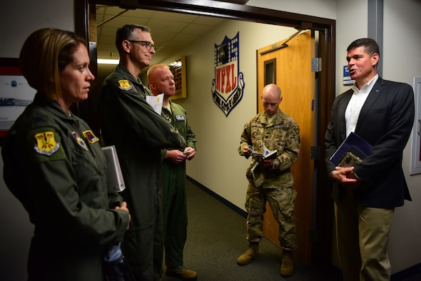 John Henderson, assistant Secretary of the Air Force for installations environment and energy, and Maj. Gen. Craig Wills, 19th Air Force commander, discuss possible problem solutions with senior leadership at Laughlin Air Force Base, Texas, July 15, 2019. While walking through Anderson Hall the group discussed pilot production increase, innovation and educational campus needs. (U.S. Air Force photo by Airman 1st Class Marco A. Gomez)