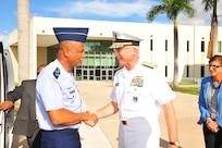 Military leaders shake hands.