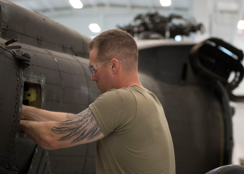 U.S. Army Pvt. Justin A. Maxwell, Charlie Company, 222nd Aviation Regiment, 1st Aviation Battalion, 128th Aviation Brigade Advanced Individual Training student, practices hands-on training during a UH-60 Helicopter Repairer course at Joint Base Langley-Eustis, Virginia, July 15, 2019.