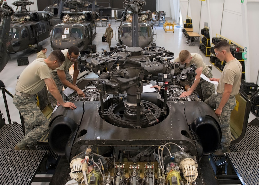 U.S. Air Force Airmen assigned to Detachment 1, 362nd Training Squadron, study engine components during a UH-60 Helicopter Repairer course at Joint Base Langley-Eustis, Virginia, July 15, 2019.