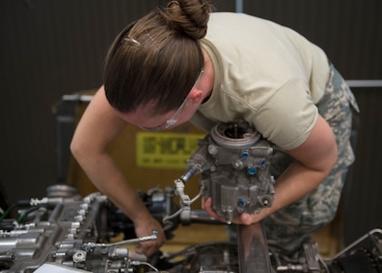 U.S. Air Force Airman 1st Class Natalie Brandt, Detachment 1, 362nd Training Squadron student, removes an engine component during a UH-60 Helicopter Repairer course at Joint Base Langley-Eustis, Virginia, July 15, 2019.