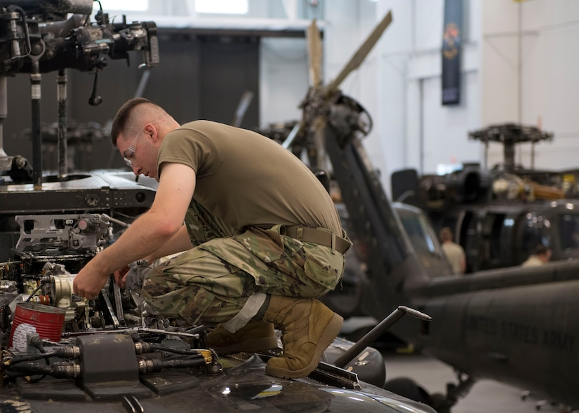 U.S. Army Pfc. Caleb Smith, Charlie Company, 222nd Aviation Regiment, 1st Aviation Battalion, 128th Aviation Brigade Advanced Individual Training student, examines an engine component during a UH-60 Helicopter Repairer course at Joint Base Langley-Eustis, Virginia, July 15, 2019.