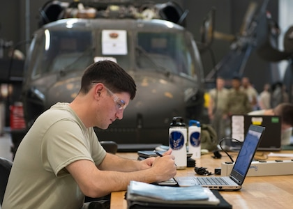 U.S. Air Force Airman Daniel Welcome, Detachment 1, 362nd Training Squadron student, studies notes during a UH-60 Helicopter Repairer course at Joint Base Langley-Eustis, Virginia, July 15, 2019.