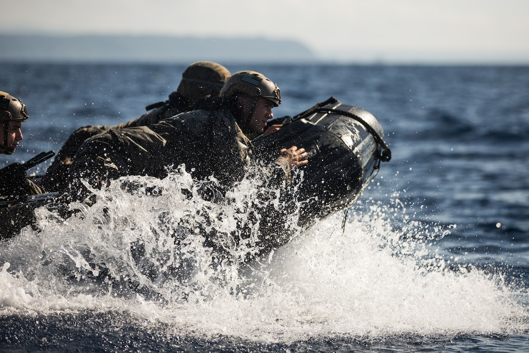 U.S. Marines with 3rd Reconnaissance Battalion, 3rd Marine Division, conduct combat rubber raiding craft training on Camp Schwab, Okinawa, Japan, July 16, 2019. While operating a CRRC, Marines maneuvered several miles into the ocean and ran drills by embarking and disembarking from the U.S.S. Germantown. Working with their Navy counterparts improves efficiency, interoperability and combat readiness.