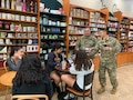 Recruiters chat with possible future soldiers