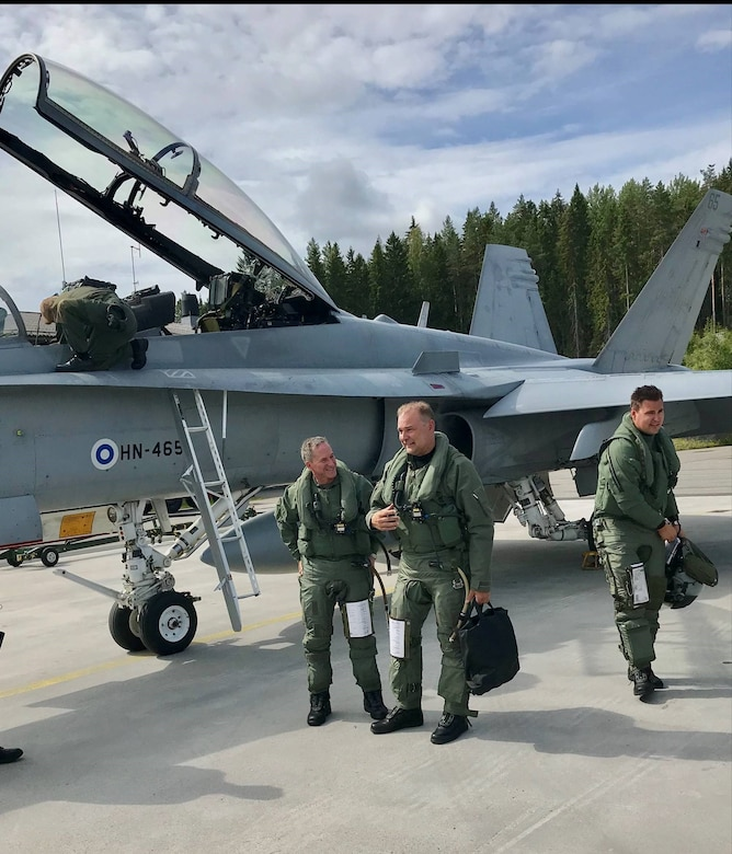 U.S. Air Force Chief of Staff Gen. David L. Goldfein discusses a just-completed training flight July 15 with Finnish Air Chief Maj. Gen. Pasi Jokinen. Goldfein was part of an F-18 training flight that allowed him to see firsthand Finland's capabilities. Afterward Goldfein said he was impressed. (Courtesy photo)
