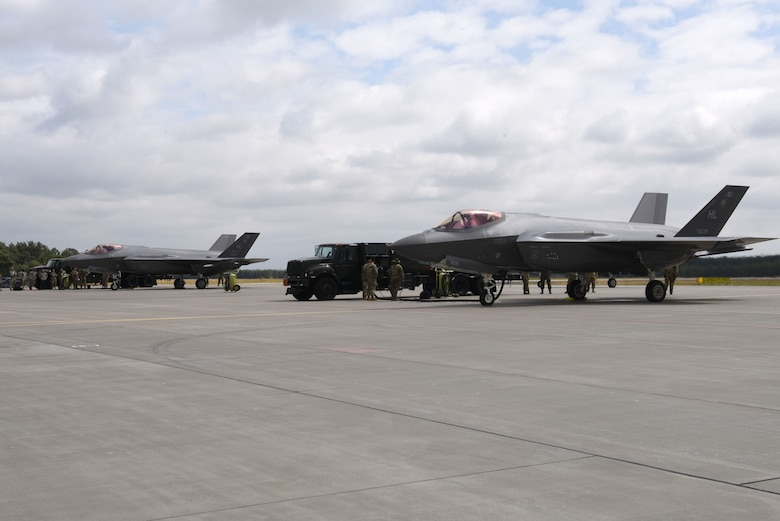 Two U.S. Air Force F-35A Lightning II aircraft, deployed from the 388th and 419th Fighter Wings, Hill Air Force Base, Utah, sit on a runway during Operation Rapid Forge on Powidz Air Base, Poland, July, 16, 2019. This is the first time that U.S. Air Force F-35A Lightning II aircraft have landed in Poland. Rapid Forge is a U.S. Air Forces in Europe-led mission to enhance readiness and test the ability to function at locations other than the main air bases.