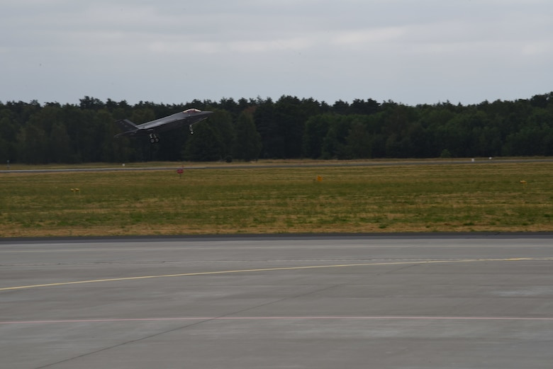 A U.S. Air Force F-35A Lightning II aircraft deployed from the 388th and 419th Fighter Wings, Hill Air Force Base, Utah, takes off during Operation Rapid Forge on Powidz Air Base, Poland, July, 16, 2019. This is the first time that a U.S. Air Force F-35A Lightning II aircraft has landed in Poland. Rapid Forge is a U.S. Air Forces in Europe-led mission to enhance readiness and test the ability to function at locations other than the main air bases.