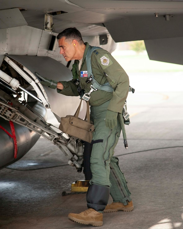 2.Lt. Gen. Marc Sasseville, Continental U.S. NORAD Region-1st Air Force (Air Forces Northern) Commander, looks over the landing gear during a pre-flight walk-around on an F-16 Fighting Falcon prior to a flight for the F-16 Senior Officer Course, hosted by the 149th Fighter Wing, Joint Base San Antonio, Texas. The four-week course, designed to requalify experienced F-16 fighter pilots, focused on advanced handling characteristics, tactical formation and instrument-flying procedures. He also regained his air-air refueling currency during the course along with flying basic fighter maneuvers. He was required to requalify in the fighter jet based on his roles and responsibilities as the CONR-1 AF (AFNORTH) Commander. (Air Force photo by Capt. Cindy Piccirillo)