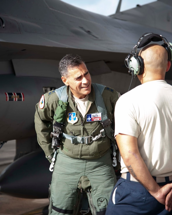 Lt. Gen. Marc Sasseville, Continental U.S. NORAD Region-1st Air Force (Air Forces Northern) Commander, talks with Tech. Sgt. Thomas Corral, F-16 Fighting Falcon crew chief with the 149th Aircraft Maintenance Squadron, prior to a flight for the F-16 Senior Officer Course, hosted by the 149th Fighter Wing, Joint Base San Antonio, Texas. The four-week course, designed to requalify experienced F-16 fighter pilots, focused on advanced handling characteristics, tactical formation and instrument-flying procedures. He also regained his air-air refueling currency during the course along with flying basic fighter maneuvers. He was required to requalify in the fighter jet based on his roles and responsibilities as the CONR-1 AF (AFNORTH) Commander. (Air Force photo by Capt. Cindy Piccirillo)