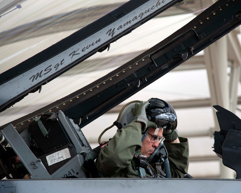 Lt. Gen. Marc Sasseville, Continental U.S. NORAD Region-1st Air Force (Air Forces Northern) Commander, adjusts his helmet that's fitted with helmet-mounted integrated targeting capability prior to a flight for the F-16 Senior Officer Course, hosted by the 149th Fighter Wing, Joint Base San Antonio, Texas. The four-week course, designed to requalify experienced F-16 fighter pilots, focused on advanced handling characteristics, tactical formation and instrument-flying procedures. He also regained his air-air refueling currency during the course along with flying basic fighter maneuvers. He was required to requalify in the fighter jet based on his roles and responsibilities as the CONR-1 AF (AFNORTH) Commander. (Photo by Capt. Cindy Piccirillo)