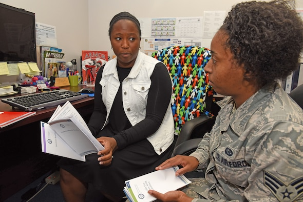 (left to right) Tavonne Bridges, Airman Family and Readiness Exceptional Family Member Program coordinator, discusses family support options within the EFMP program with U.S. Air Force Senior Airman Jalynn Wilford, 88th Force Support Squadron Military Personnel Flight Retentions counselor. Bridges assists military family members that have special needs navigate through medical, educational and environmental resources. (U.S. Air Force photo/Michelle Gigante)