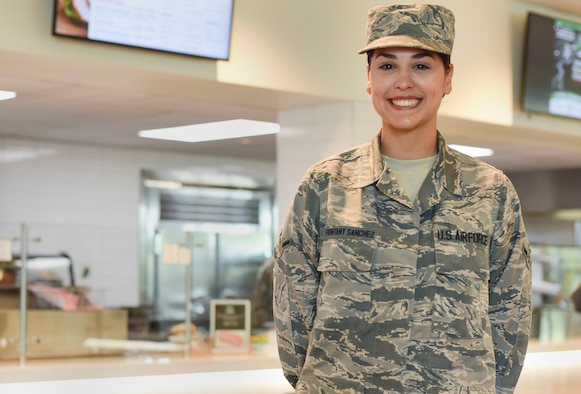Airman Yolinette Frontany Sanchez, 341st Force Support Squadron food service apprentice, poses for a picture July 16, 2019, at the Elkhorn Dining Facility on Malmstrom Air Force Base, Mont.
