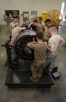 Aerospace propulsion Airmen assigned to the 509th Maintenance Squadron jet propulsion flight, train together to perform maintenance on an F-118 engine on July 9, 2019, at Whiteman Air Force Base, Missouri. The flight runs diagnostic tests and perform regular maintenance on F-118 engines on a daily basis to ensure the readiness of the B-2 Spirit fleet at Whiteman AFB. (U.S. Air Force photo by Staff Sgt. Kayla White)
