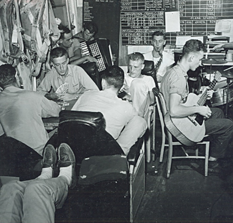 Pilots aboard the USS Monterey, built as a light carrier, keep busy while other pilots are attacking Japanese land-based aircraft, June 1944. During World War II, the number of aircraft aboard a light carrier was only one-half to two-thirds that of a full-sized fleet carrier. Similar to the smaller escort carrier, the light carrier had the speed for deployment with the larger fleet carriers.