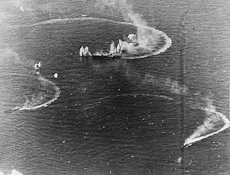 The Japanese carrier Zuikaku (center), which took part in the Japanese attack on Pearl Harbor, Dec. 7, 1941, and two destroyers under attack by Navy carrier aircraft, June 20, 1944. American aircraft sank her in the battle of Cape Engano on Oct. 25, 1944, during the battle of Leyte Gulf.