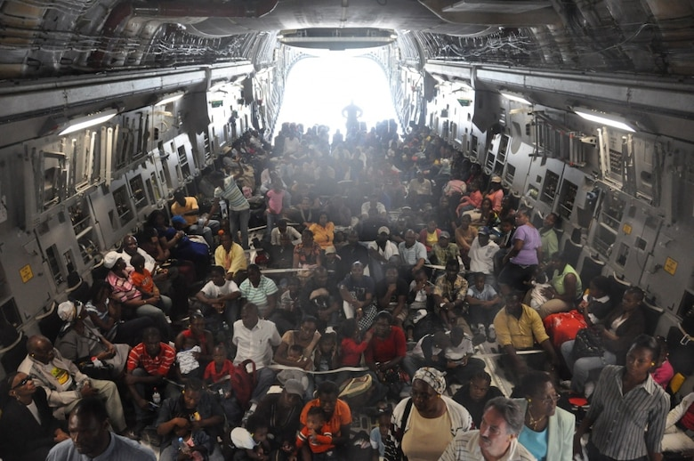 Haitians displaced by an earthquake are evacuated in a C-17 Globemaster III, January, 2010. More than 27 thousand people were airlifted to safety in the wake of the disaster.