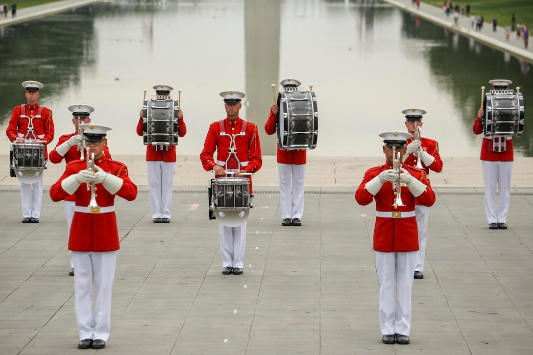 Marines holding various instruments stand in formation.