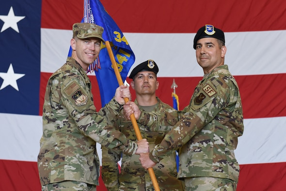 Col. Frank Reyes, right, accepts command of the 341st Security Forces Group from Col. Russell Williford, 341st Missile Wing vice commander during a change of command ceremony July 17, 2019, at Malmstrom Air Force Base, Mont.