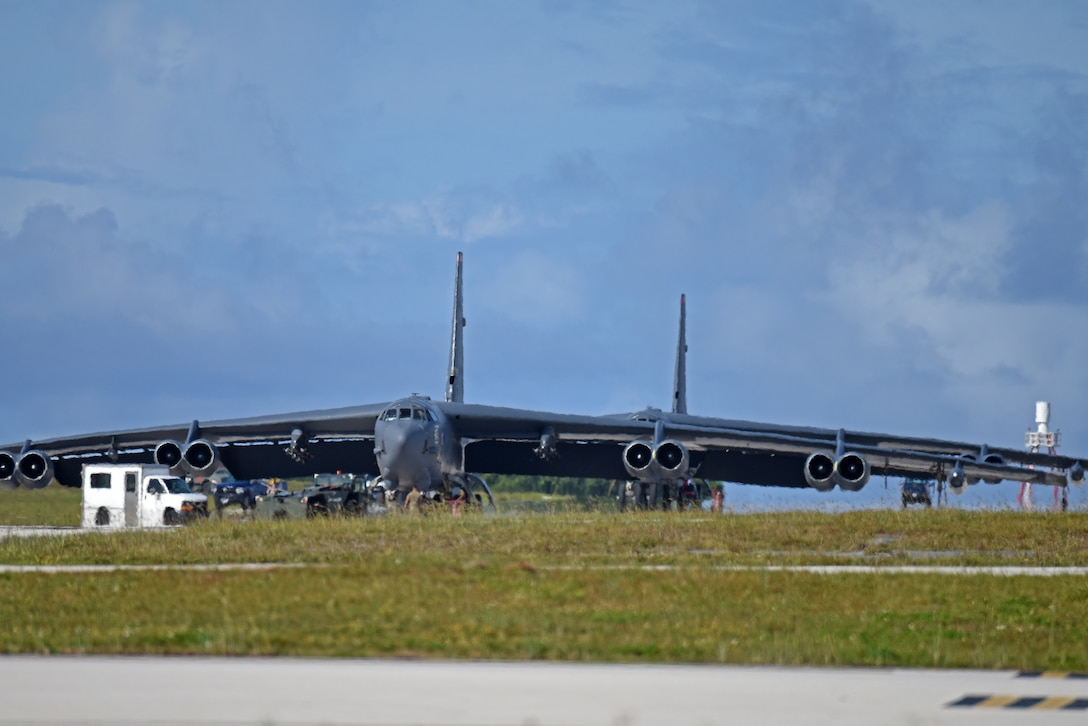 Two B-52 Stratofortress bombers from the 69th Expeditionary Bomb Squadron, deployed from Minot Air Force Base, North Dakota, land July 12, 2019, at Andersen Air Force Base, Guam.